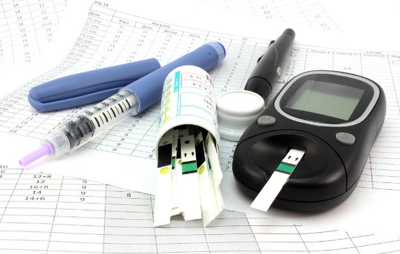 A selection of diabetes equipment across a table.