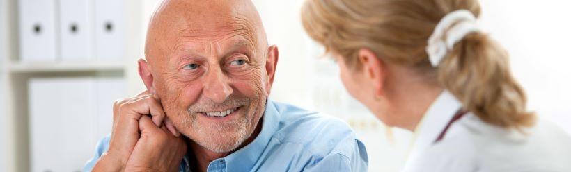 Man in conversation with nurse